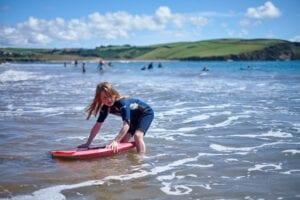 Young girl surfing in Devon
