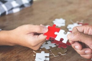 completing a jigsaw puzzl