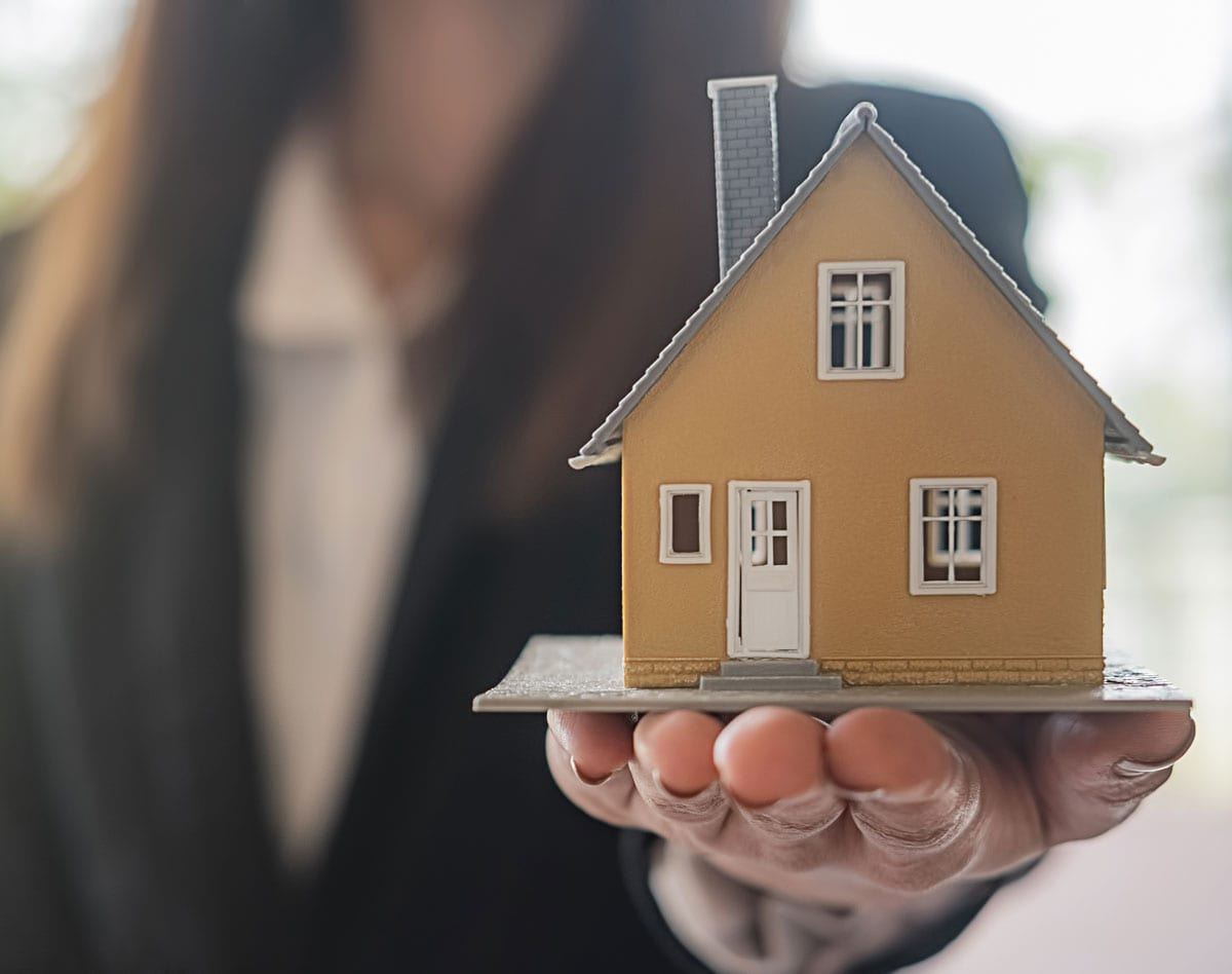 Lady holding house - Can divorce force the sale of my house?