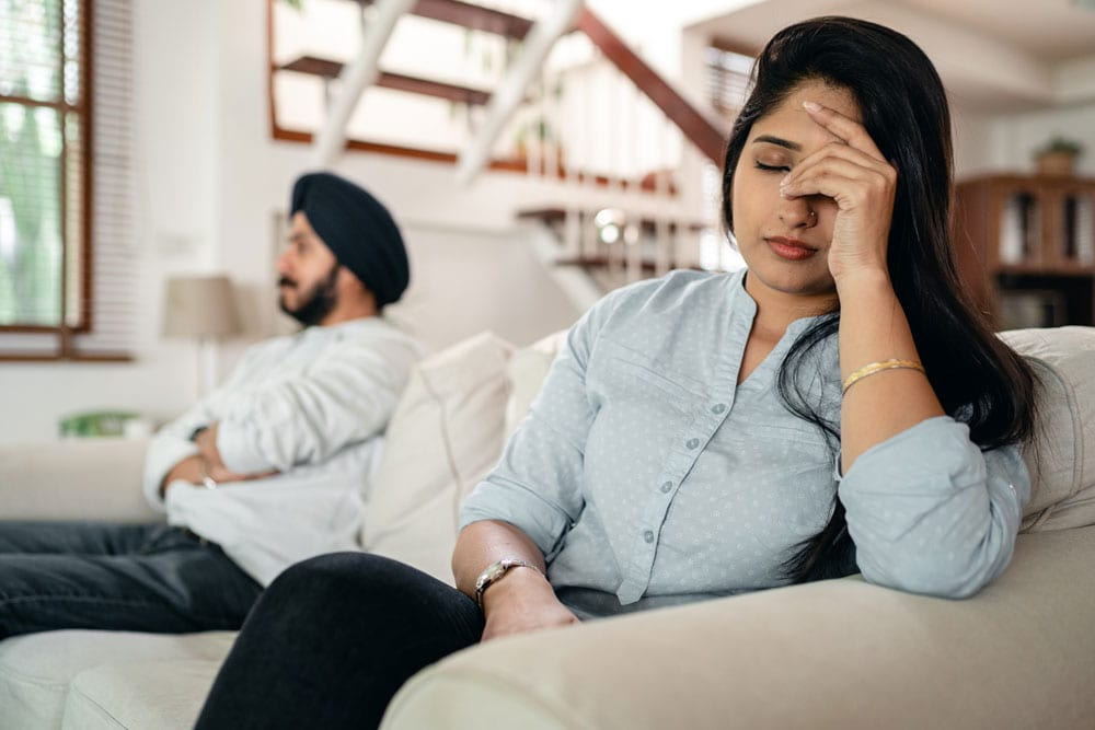 young indian couple upset tax implications of a divorce
