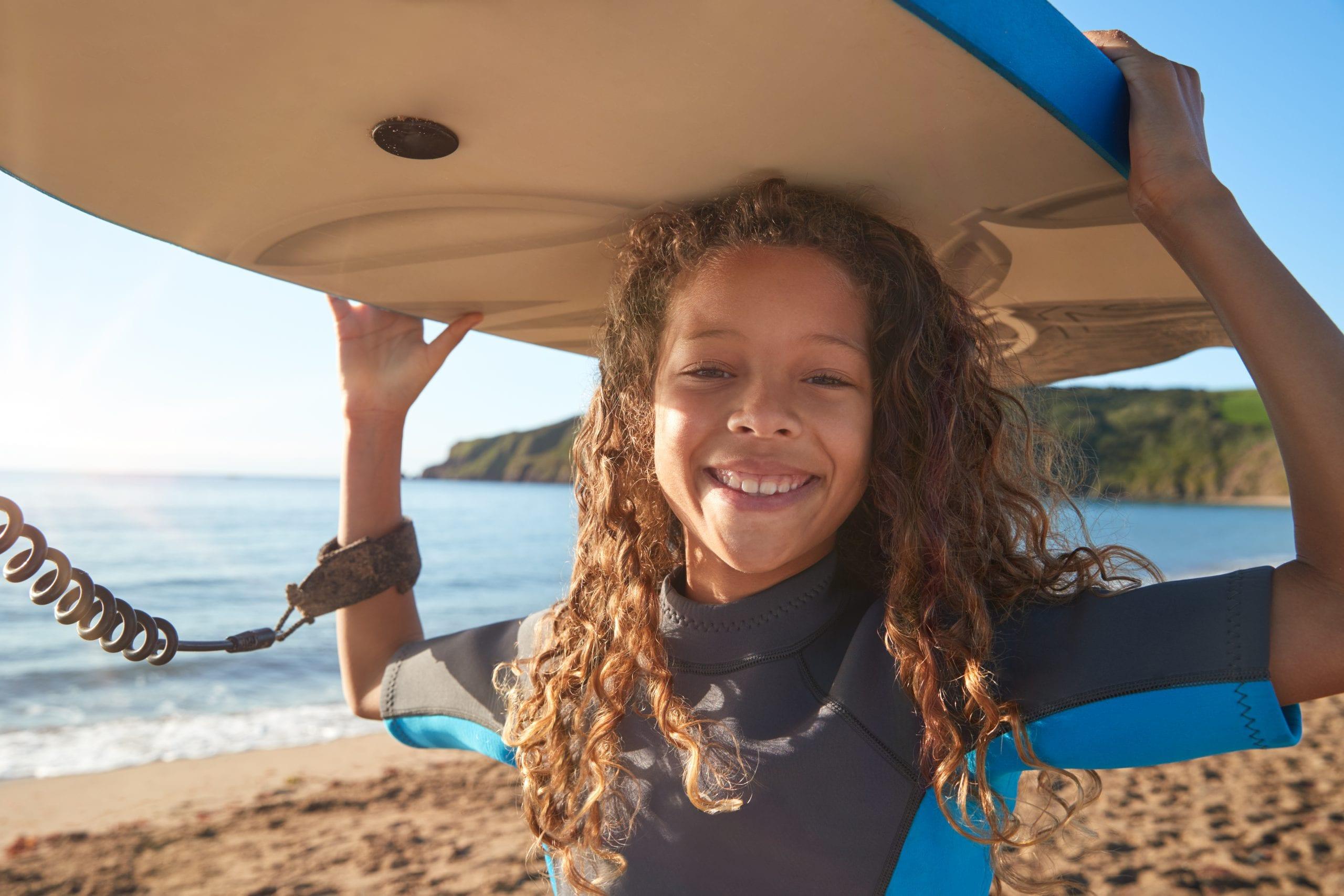 child surfing on beach